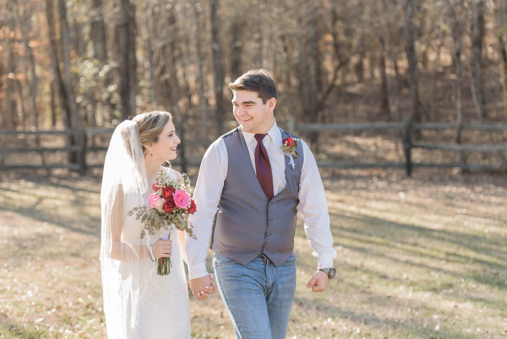 bride groom walking through forrest